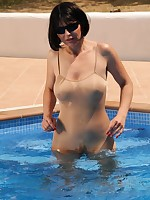Pantyhose Diva gets wet in her swimming pool - Granny Classic